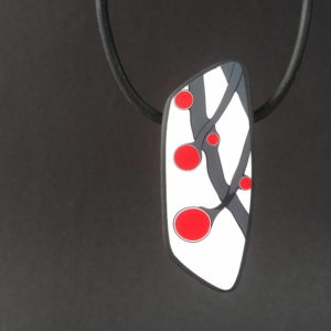 Handmade necklace with a single bead showing a graphic flower bud motif in red, on a white background with a charcoal border. It is approximately 2.6 cm wide and 6.4 cm long and hangs on a black adjustable cord.