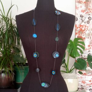 Handmade long necklace with individually crafted beads in fresh blues and greens. Inspired by peacock feathers. Necklace length approx. 120cm.