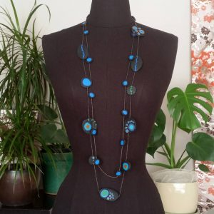 Handmade long necklace with individually crafted beads in fresh blues and greens. Inspired by peacock feathers. Necklace length approx. 120cm