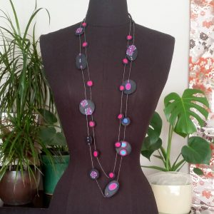 Handmade long necklace (120cm) with individually crafted organically shaped beads in a vivid combination of purple and magenta dots.
