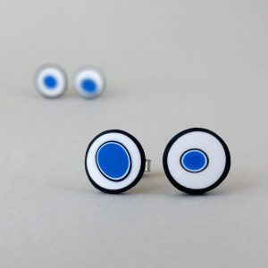 Handmade stud earrings with organic circles of cobalt blue on a white background with a black border.