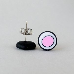 Handmade stud earrings with organic circles of pale pink on a white background with a black border.