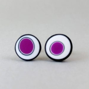 Handmade stud earrings with organic circles of purple on a white background with a black border.