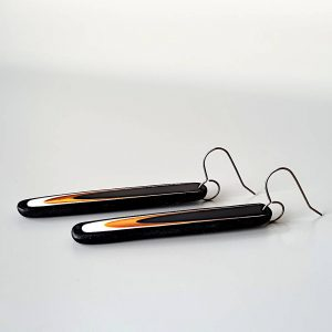 Handmade long dangle earrings with a clean, modern pattern in black, gold and white. Hand crafted titanium earwires.