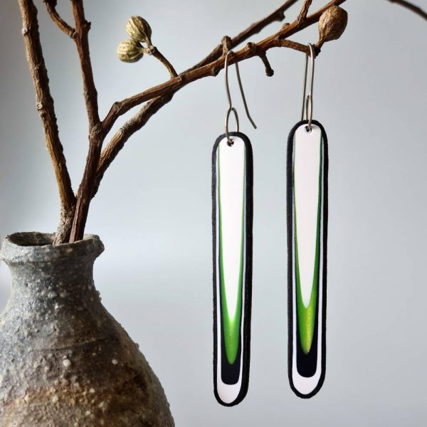 Handmade long dangle earrings with a clean, modern pattern in black, lime green and white. Hand crafted titanium earwires.