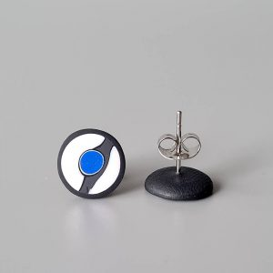 Handmade stud earrings with asymmetrical abstract flower bud pattern in blue tones, on a white background with a charcoal border. Titanium posts.