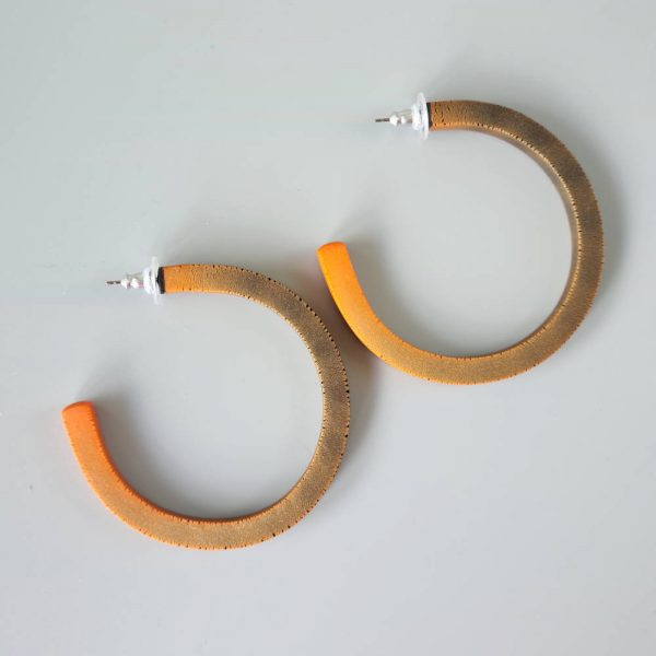 Handmade large hoop earrings in shimmering orange with ombre effect. Titanium posts.