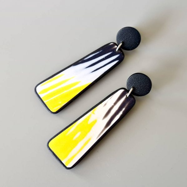 Handmade dangle earrings with zigzag pattern in black, white and sunshine yellow.